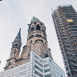 The Protestant Kaiser Wilhelm Memorial Church is located in Berlin on the Kurfürstendamm in the centre of the Breitscheidplatz.  The original church on the site was built in the 1890s. It was badly damaged in a bombing raid in 1943. The damaged spire of the old church has been retained and its ground floor has been made into a memorial hall.  The Memorial Church today is a famous landmark of western Berlin. by Valeria Vanessa - Instagram & Mobile Instagram ( vscocam, visitberlin, premiumposts, wanderfolk, livefolk, liveauthentic, FoundLost, goodtravelersjournal, ig_germany )