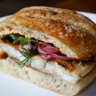 Flounder Sandwich Marinated in Fish Sauce, with Sriracha Mayonnaise and Pickled Red Onions