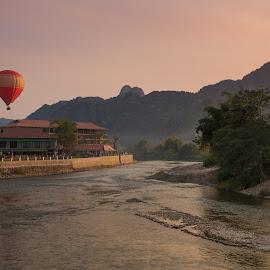 Vang Vieng, Laos by Tim Pryce - Landscapes Travel ( hot air balloon, laos, sunset, vang vieng, travel, landscape, dusk, river )