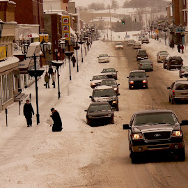 Frontenac street by Suzanne Blais - City,  Street & Park  Street Scenes ( street winter buildings cars snow main lake-megantic )