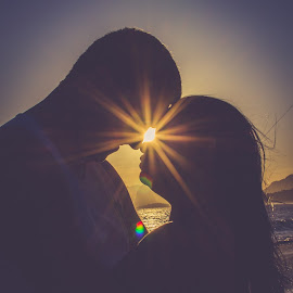 Lovers at Sunset by José Tavares - People Couples ( silhouette, sunset, couple, flare, couples )