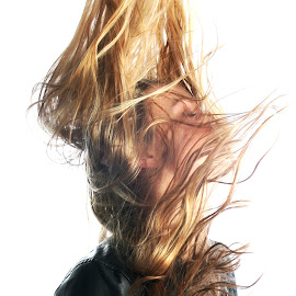 Stopped action by Angela Wilkens - People Fashion ( wind, model, blonde, leather, hair )