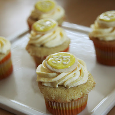 Italian Cream Cupcakes with Lemon Curd Filling and Lemon Buttercream, with a sugar cookie decoration on top