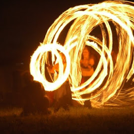Fire dancers at the SCA festival Warren War by Charles Dawson - People Musicians & Entertainers