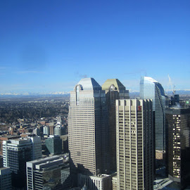 Calgary, Alberta by Linda Doerr - City,  Street & Park  Skylines ( cityscapes, mountains, blue sky, high rise, buildings )