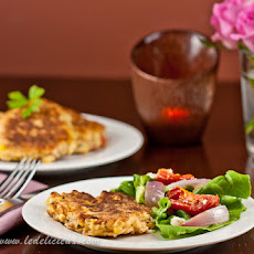 Sweetcorn Fritters with roasted tomato & red onion salad