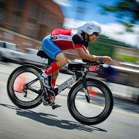 At the Ironman in Coeur D'Alene today. The idea was to capture the rider while panning the camera and blur the background. It took a while to get adjusted to the speed of the bikes. I liked this one. by Clement Stevens - Uncategorized All Uncategorized ( land, device, transportation )