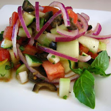 Cucumber Tomato Salad With Zucchini and Black Olives and a Lemon
