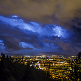 The storm by Tilyo Rusev - City,  Street & Park  Night ( navarra, europe, colorful, shine, cityscape, glow, storm, landscape, spain, city, lights, lightning, nature, blue, pamplona, force, high, light, energy )