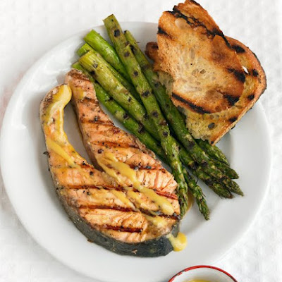 Grilled Salmon Steaks with Mustard Sauce and Asparagus