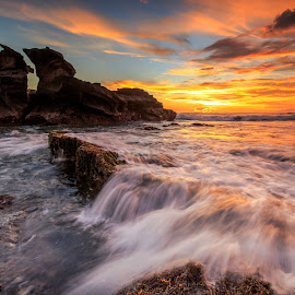 melasti by Didik Putradi - Landscapes Sunsets & Sunrises ( canon, sunset, beach, motion, rocks )