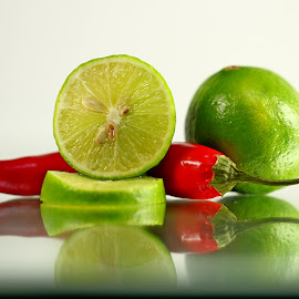 by Dipali S - Food & Drink Fruits & Vegetables ( red, pepper, slice, vegetable, llime, chili )