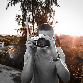 Capture the moment  by Andrew J Knepper - People Portraits of Men ( film, selective color, black and white, sunset, camera, capture, photographer, self portrait, haiti, portrait, Selfie, self shot )