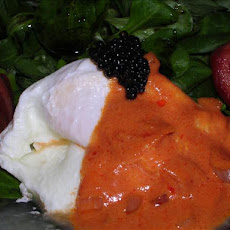 Poached Eggs on Field Salad With Tomato Sauce and Caviar