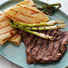 Korean-Style Marinated Skirt Steak with Grilled Scallions and Warm Tortillas