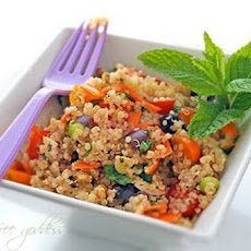Quinoa Salad with Yellow Tomatoes, Kalamata Olives, Basil + Mint