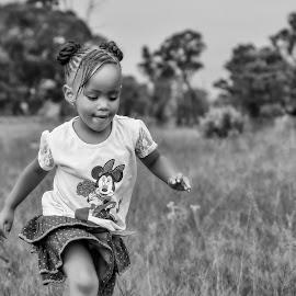 Running in the field by Matt Stern - Babies & Children Children Candids ( child, african, black and white, matt stern photography, south africa, children candids, children )