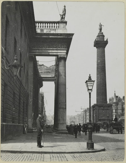 Many of the early shots in the album were taken from the summit of Nelson's Pillar in the centre of Sackville Street (now O' Connell  Street), roughly where the Dublin Spire now stands. This perspective gives a bird's-eye view down onto the debris, particularly into the shell of the General Post Office. Nelson's Pillar was a focal point of the city and a famous public attraction, until it too was destroyed (by the IRA in 1966). For sixpence visitors could ascend the 168 spiral steps built into its interior – not an easy climb for a middle-aged man carrying his own heavy camera equipment. That Westropp made the effort is a sign of his determination to make good use of the Pillar as a uniquely dramatic vantage point.