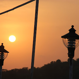Lamps enlightened by the evening sun. by Thakkar Mj - City,  Street & Park  Street Scenes ( orange, sunset, lamp, evening, sun,  )