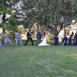 Tug O War  by Nancy Lowrie - Wedding Groups ( Wedding, Weddings, Marriage )