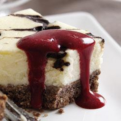 Carte D'Or Vanilla and Chocolate Cheesecake with Raspberry Coulis