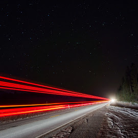 Cruising under a starry sky by Leon Kauffman - Transportation Roads ( headlights, montana, snow, taillights, long exposure, swan valley, road )