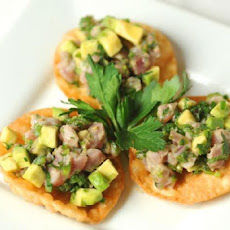 Tuna and Avocado Tartare with California Caviar on Sesame Wonton Crisps