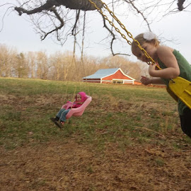 Gwyneth and I are swinging and I ask her  by Lisa Whitfield - Babies & Children Children Candids