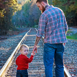 Daddy and son by Carol Plummer - People Family ( family, son, boy, people, man )