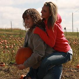 sisterly love  by Dale Wooten - People Couples ( good looking, girls, apple fest, blonde, sisters, pumpkin )