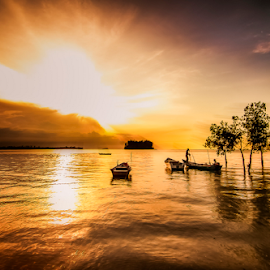Done for the Day. by Victor Sim - Landscapes Sunsets & Sunrises ( clouds, tropical. warm, sky, sunset, boats, golden hour., reflections, landscape )