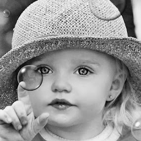 Hats & Bubbles B & W by Cheryl Korotky - Black & White Portraits & People ( hats, magical pictures, child model peyton, a heartbeat in time photography, amazing faces, bubbles, beautiful children, b & w,  )