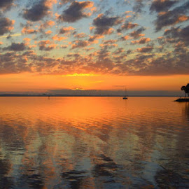 Indian River Lagoon Sunrise by Rich Eginton - Landscapes Sunsets & Sunrises ( orange, lagoon, indian river, sunrise, boat )