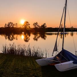 Katamaran by Christian Krammer - Transportation Boats ( reflection, sunset, lake, boat, sun, katamaran )