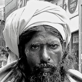 PORTRAIT OF A HOLY MAN by Doug Hilson - People Portraits of Men ( stern face, india, holy, man, portrait, black&white, weathered face )