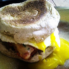 Veal Parmesan Morning Sandwich with a Fried Egg on Whole Wheat English Muffin