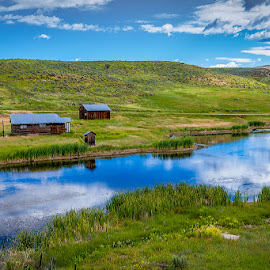 Serenity by Jason Hutchison - Landscapes Prairies, Meadows & Fields ( water, reflection, barn, blue, green, cloud )