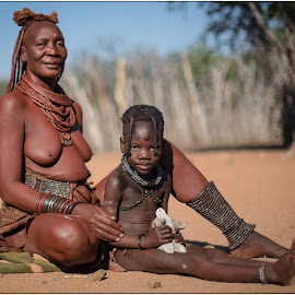 Himba Grandmother and Granddaughter with clay doll by Rick Venter - People Portraits of Women