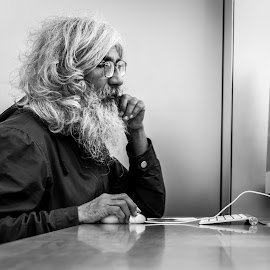 Human Vs Technology by Amro Labib - People Portraits of Men ( natural light, old, indoor, black and white, street, white, candid, portrait, street photography, pose, australia, beard, black, man, sydney )