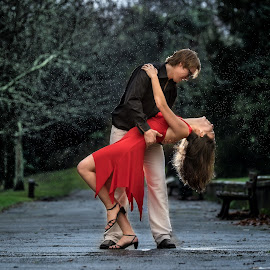 dance in the rain by Lukas Gisbert-Mora - People Couples ( fuji, salsa, passion, rain, flash photography, couples, improving mood, moods, red, love, the mood factory, inspirational, passionate, enthusiasm )
