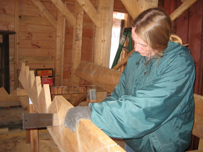 Wendy finishes cutting out the steps with the pullsaw