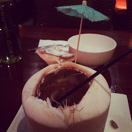 There's an umbrella on my coconut by Vania R - Food & Drink Fruits & Vegetables