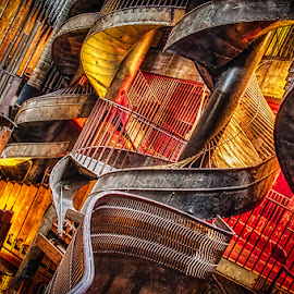 St. Louis Chutes and Ladders by Betsy Wilson - Buildings & Architecture Architectural Detail ( chutes and ladders, city museum, moods, lighting, staircase, st. louis, slide, steel, mood lighting, winding stairs )