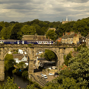 Knaresborough  by Ron Jnr - Buildings & Architecture Bridges & Suspended Structures ( clouds, houses, knearsborough, rail bridge, summers day, landscape, church spire, railway carriages, north yorkshire, railway, trees, landscape photography, bridge, homes, river )