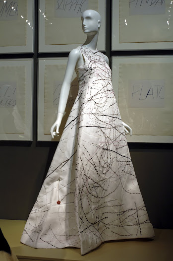 "The ""Twombly Swan"" gown is made of white silk gazar and embroidered by the house of Lesage. Tumultuous swirls of black, gray, red and ivory evoke the 1955 Twombly works The Greeks, Criticism, Free Wheeler, and Academy."