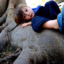 Contemplative by Scott Cove - Babies & Children Child Portraits ( big eyes, outdoors, laying, boy, portrait )