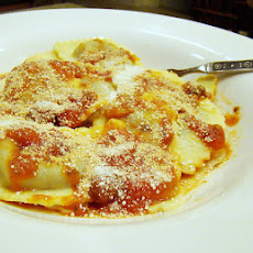 Ravioli With Tomatoes, White Beans, and Escarole