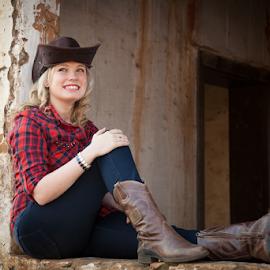 Cowgirl in window by Johan Niemand - People Portraits of Women ( blonde, cowgirls, window, jeans, denim, ruins, hat )