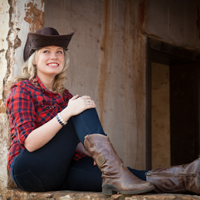 Cowgirl in window by Johan Niemand - People Portraits of Women ( blonde, cowgirls, window, jeans, denim, ruins, hat )