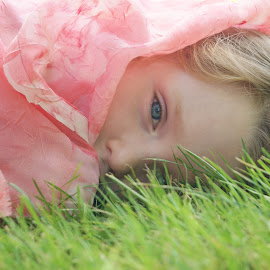 Watching Grass Grow by Cheryl Korotky - Babies & Children Child Portraits ( reclining pose, grass, a heartbeat in time photography, amazing faces, blue eyes, beautiful children, child model nevaeh, portrait )